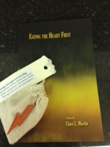 The gris gris bag for courage with Clare's book of poetry, my prizes from Words of Fire, Words of Water.