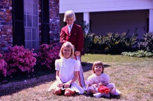 Easter photo with me, the oldest sitting, my brother and my younger sister.