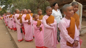 Girls shave their heads to attend a nun school.