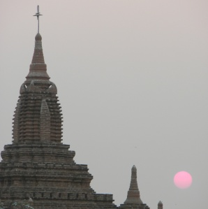 A pagoda, a Buddhist holy temple, at sunset.