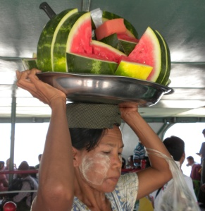 Women carry foods and other things on their heads.