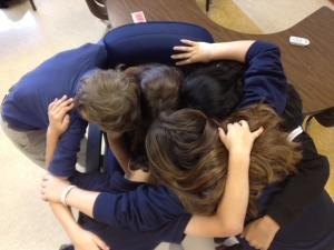 Class group hug, saying goodbye.