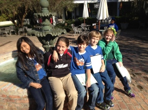 Students pose at the outdoor fountain.