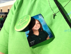 The button and Kamryn's picture on my t-shirt.