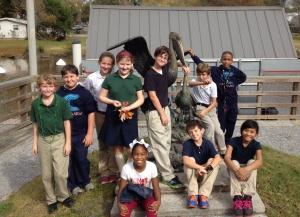 students at Pelican sculpture