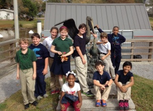 students at Pelican sculpture