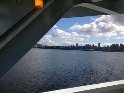 Through the window of the ferry, we sail away from Seattle.