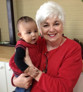 Solomon House volunteer, Betty, holds precious Melachi.