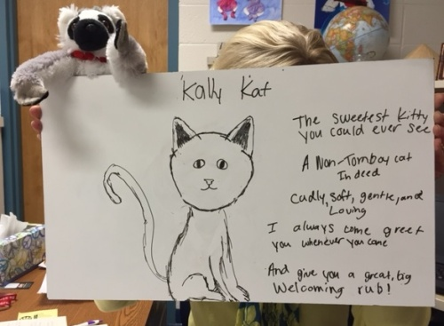 Emily illustrated her poem and took a picture of me and Jack (the lemur) holding it up.