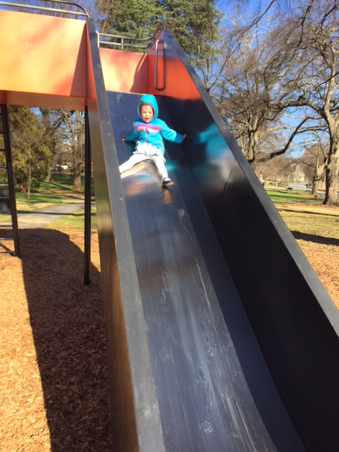The joy of being four on a big tall slide!