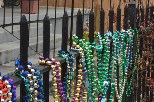 Many people decorate fences and trees with beads.
