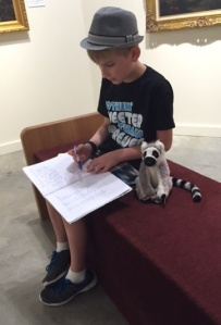 Hayden reads his story to Jack, the lemur.