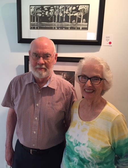 My parents, Dot and John Gibson with Dad's art.