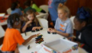 Students play strategic games at Gifted by Nature Day.