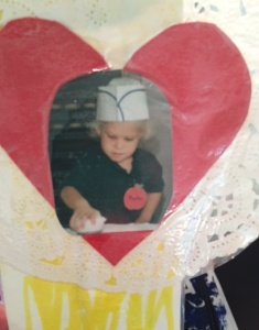 A serious donut maker, my daughter in pre-K or Kindergarten.