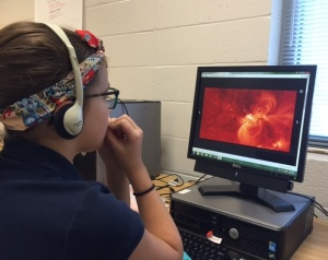 Lani watches a video about solar storms on Wonderopolis.
